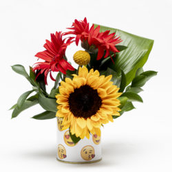 Burst of Happiness. This cheerful combination of the sunflower, crespedia balls and gerberas in the emoji tin will put a smile on anyones face