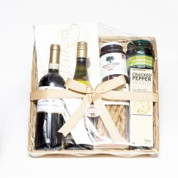 This Duo Wine Savoury and Sweet Hamper consists of red and white wine, savoury crackers, olives, fig jam and a box of chocolates. We deliver nationally.