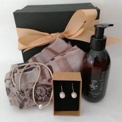This Gift Hamper A contains fresh water pearl jewelry, Terra Firma hand and body wash and a lovely scarf. We Deliver Nationally.